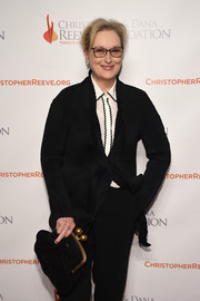 Meryl Streep arrived for the 'Magical Evening' event carrying a classic black frame clutch with gold hardware.