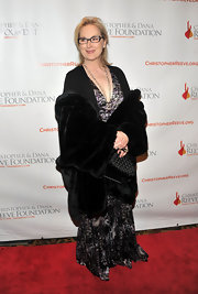 Meryl Streep wore a long velvet maxi-dress under her layers for the Magical Evening Gala.