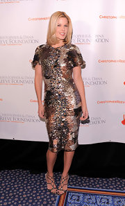Mary Alice Stephenson matched a glimmering sequin cocktail dress with super strappy metallic heels.