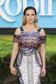Hayley Atwell paired a silver Edie Parker clutch with a sequined cold-shoulder dress for the European premiere of 'Christopher Robin.'