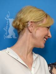 Cate Blanchett attended the 'Cinderella' photocall wearing her hair in a loose side bun.