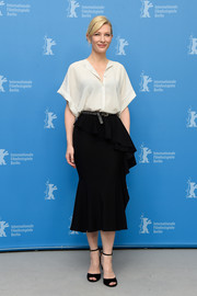 Cate Blanchett was casual-chic at the 'Cinderella' photocall in a languid white blouse by Givenchy.