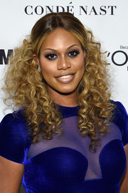 Laverne Cox sported tight curls in a center-parted, half-up style during the Glamour Women of the Year Awards.