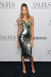 Romee Strijd caught eyes in a skintight chartreuse sequin dress by Alex Perry at the 'Angels' by Russell James book launch.