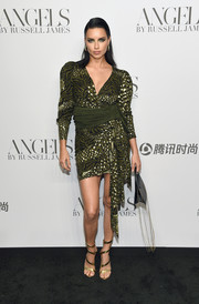 Adriana Lima went for sexy styling with a pair of strappy gold heels.