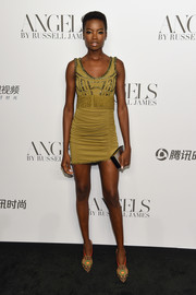 Maria Borges flaunted her slim figure in a ruched olive-green mini dress by Roberto Cavalli at the 'Angels' by Russell James book launch.