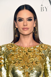 Alessandra Ambrosio kept it simple with this center-parted 'do at the 'Angels' by Russell James book launch.