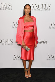 Lais Ribeiro styled her look with gold ankle-strap sandals by Gianvito Rossi.