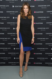 Cindy Crawford flaunted her ageless figure in a ruched two-tone dress with a high side slit at the Talking Top Design event.