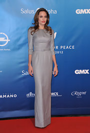 Angelina Jolie wore this retro-inspired gray column sheath dress to the Berlin Film Festival.