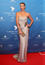 Charlize Theron was a silver siren in this strapless pleated gown with an Art Deco vibe