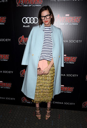 Underneath her coat, Jenna Lyons sported a Christmassy gold pencil skirt and a black-and-white striped top.