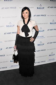 Stacey Bendet rocked a punk-inspired look with this cream blouse that featured a black bow and a long tiered skirt.