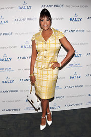 Vivica A. Fox showed off her curves with this yellow plaid skirt suit.