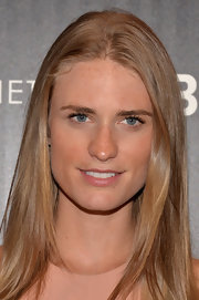 Julie Henderson showed off her long blonde locks with a sleek, center-parted straight style.