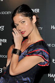 Jill Hennessy accented her printed dress with a bronzed cuff bracelet.