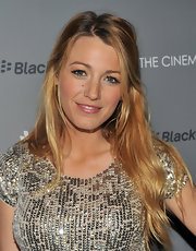 Blake Lively was shining in a sequined top and luminous makeup that included a pearlescent pink lipstick at a screening of 'Haywire.'