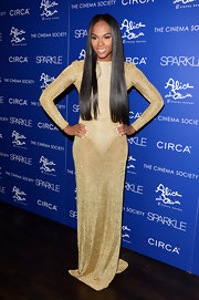 Tika Sumpter was solid gold in this shimmering sheer dress at the 'Sparkle' premiere.