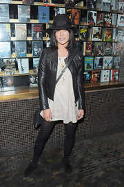 Jessica Szohr opted for a low-key look at a screening of 'Breaking Dawn' in a black leather jacket and a beige tunic.