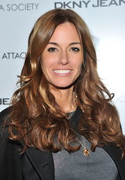 Kelly Bensimon showed off radiant brown locks at the screening of 'No Strings Attached'.