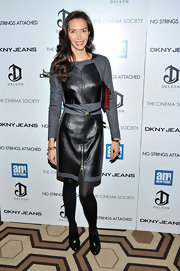 Olivia donned a leather clad frock with a unique zipper slit at the front.