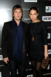 Rob Thomas adds depth and warmth to his outfit with a navy blue wool scarf. The scarf matches the singer's baby blues!