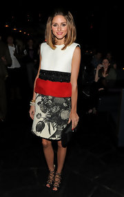Olivia Palermo accented her multi-textured evening look with a black satin clutch.