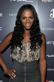Tika Sumpter looked super feminine with these tight curls at the screening of 'Henry's Crime.'
