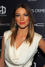 Natalie Zea spiced up her glowing look with ravishing red lipstick.