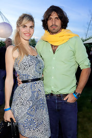 European men do love their scarves! Here, Nacho Figueras walks on the bright side, pairing his green shirt with a bright yellow scarf.