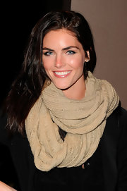 Hilary Rhoda kept cozy with a beige knit scarf.