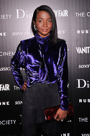 Genevieve Jones looked sharp in a purple velvet turtleneck shirt at The Cinema Society screening of 'Rust And Bone.'