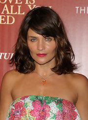 A bright fuchsia lip color added some color and whimsy to Helena Christensen's red carpet look in NYC.