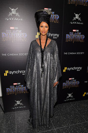 Iman looked queenly in a flowing silver caftan at the screening of 'Black Panther.'