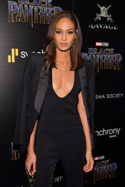 Joan Smalls teamed a tux jacket with a low-cut jumpsuit for the screening of 'Black Panther.'