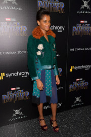 Letitia Wright paired a green shearling jacket with a mixed-print dress, both by Coach, for the screening of 'Black Panther.'
