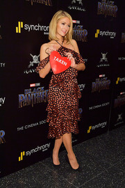 Paris Hilton coordinated her dress with a Sara Battaglia x Bat Gio 'Taken' heart bag.