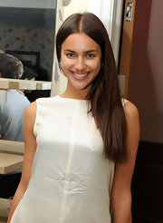 Irina Shayk kept her tresses sleek and simple with a center part straight cut.