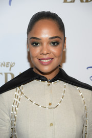 Tessa Thompson prettied up her eyes with emerald-green shadow.