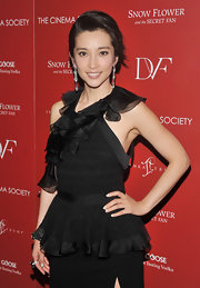 Li Bingbing walked the red carpet with a funky updo that framed her diamond accessories.