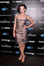 Roxane Mesquida chose a purple and gold, distressed metallic dress for her red carpet look at 'The Host' NYC screening.