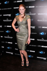 Christiane Seidel chose a metallic cocktail dress with a scalloped, baroque-inspired neckline for her red carpet look at 'The Host' screening in NYC.