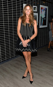 Kelly Bensimon kept it girly in a black-and-white fit-and-flare mini dress during the premiere of 'Diana.'
