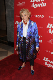 Candice Bergen attended a screening of 'Home Again' wearing a printed coat over a white shirt and black trousers.