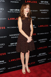 Isabelle Huppert went for a classic look with a sleeveless print dress at the screening of 'Lawless.'