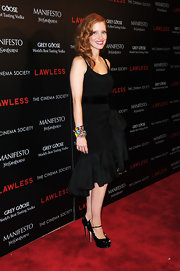 Jessica Chastain's livened up her LBD and black peep-toes with a very vibrant beaded bracelets.