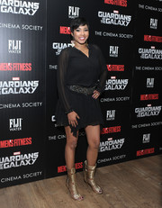 Alicia Quarles donned a short black shirtdress with a glittery belt for the 'Guardians of the Galaxy' screening.
