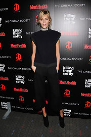 Anja Rubik completed her look with a pair of simple black ankle boots.