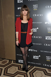 Rose wears a sleek red boyfriend blazer over her LBD for the premiere of 'Cracks' in NYC.