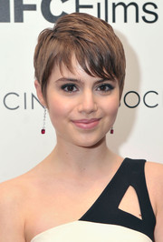 Sami Gayle added a luxe touch with a pair of dangling ruby and diamond earrings.